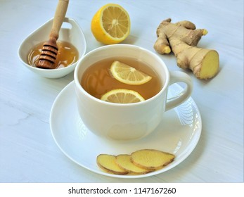 Hot Ginger tea with honey and lemon, warming drink.