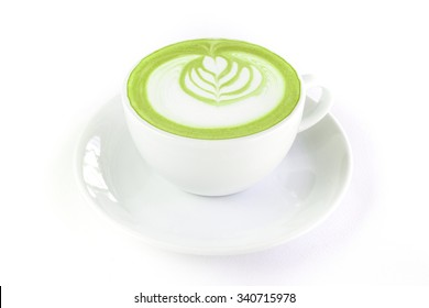 Hot green tea matcha latte in a cup white background isolated