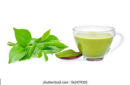 Hot green tea matcha latte with powdered green tea and tea leaves  isolated on white background.
