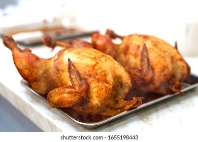 Hot grilled chicken on a tray