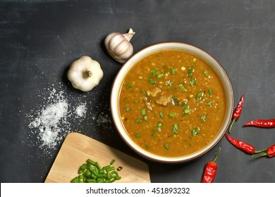 hot haleem soup with ingredients tabletop