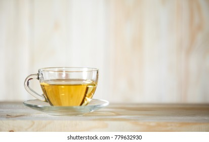 Hot herbal healthy tea with ingredients and vitamin in the cafe table white color. Glassware. Place to copy paste.