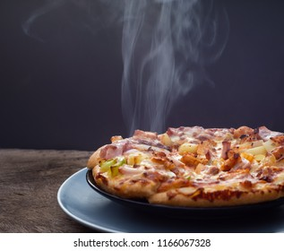 Hot Homemade Pepperoni Pizza on the plate with Steaming  Ready to Eat