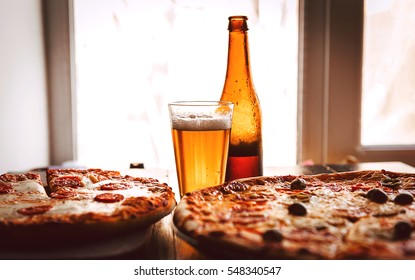 Hot Homemade Pepperoni Pizza Ready to Eat with a glass of beer
