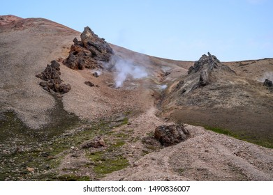 Hot hydrogen sulfide steam coming out of the ground on a rocky hillside at Landmannalaugar highlands, Iceland