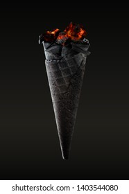 Hot ice cream combustion in horn black waffle, charcoal burn, grey-black color background - Image