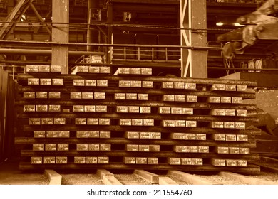Hot ingot piled up together in a steel plant, closeup of photo