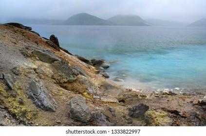 Hot lake in caldera of Golovnina volcano, Kunashir island, Russia