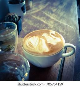 hot latte in cafe ,vintage filter
