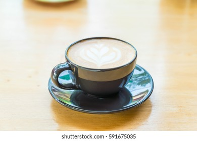 hot latte coffee cup on table