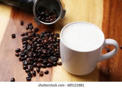 Hot latte , hot coffee and milk foam on wood floor