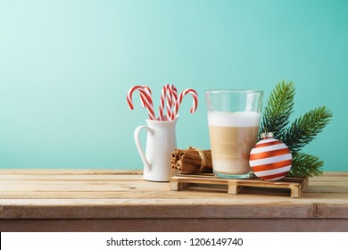 Hot Latte macchiato coffee cop  on wooden table. Christmas menu concept