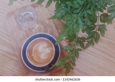 Hot Latte on wooden table