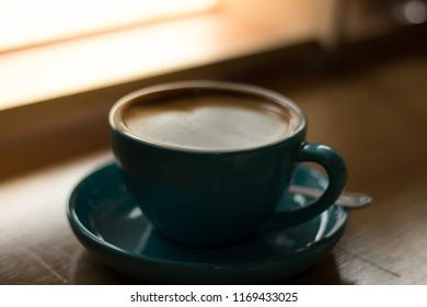 Hot Latte on the wooden table