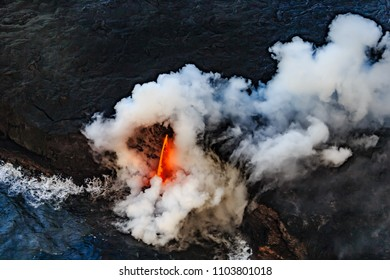 Hot lava falls into the Pacific Ocean causing explosions and gas