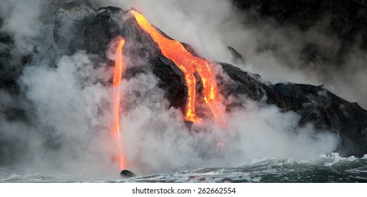 Hot lava stream is flowing into the ocean. Hawaii, Big Island.