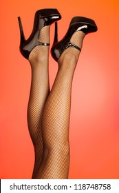 Hot legs wearing fishnet stockings