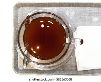 Hot lemon tea served on plastic trays.
