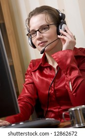Hot line operator with headset at office