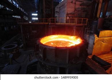 The hot liquid metal into the ladle. Electric arc furnace shop EAF. Metallurgy.