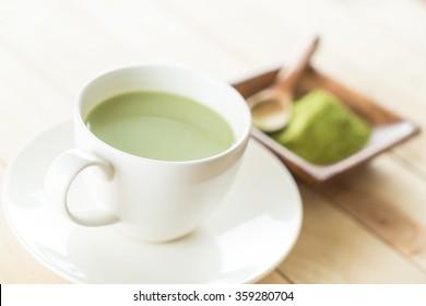 hot matcha latte on wood