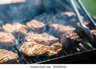 Hot meat is cooked on the grill