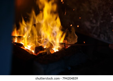 Hot metal in the fire before being hammered by a blacksmith