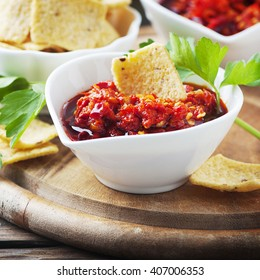Hot mexican salsa with chili peppers, selective focus and square image