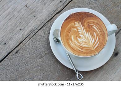 hot milk art coffee on wooden table