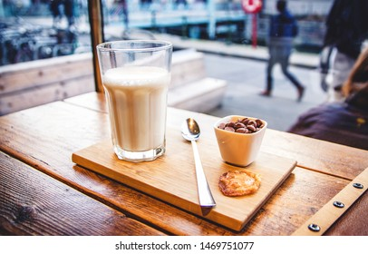 Hot milk and chocolate chips in a cozy bar in the afternoon