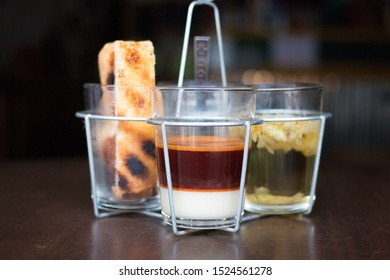 hot milk tea and hot chrysanthemum tea and toast on old wooden table.Traditional tea can be found in the Southeast Asian countries.Southern Thailand and Malay style.Vintage and classic.