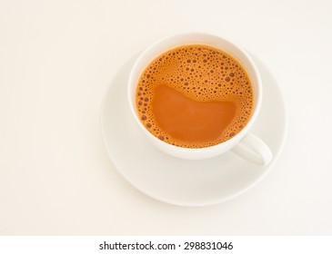 Hot milk tea in white cup on white background,  Tea with milk and bubble on white, Hot tea relax sweet drink time, Milk tea or hot tea milk