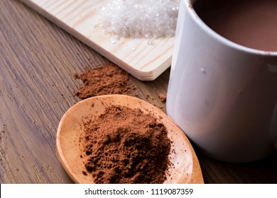 Hot Milo with Milo Powder and Sugar on The Wooden Table. Visible Noise,Blur Available When View at Full Resolution.
