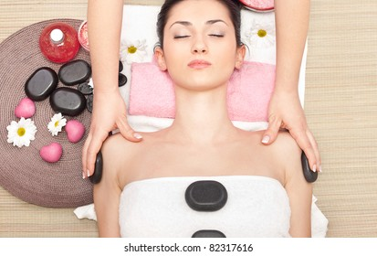 hot mineral stone treatment at spa salon, top view