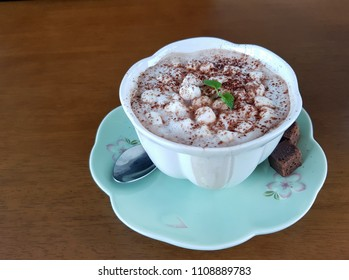 hot mint chocolate with marshmallow, on wood table