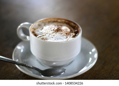 Hot mocha coffee in the morning in a white glass