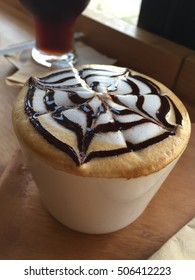 Hot mocha topping with chocolate latte art painting