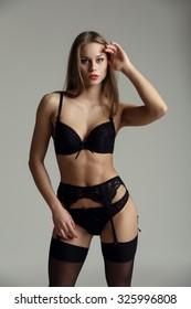 Hot model posing in tempting black lingerie set