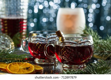 Hot mulled red wine on christmas table with bokeh light background.