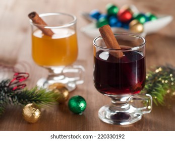 Hot mulled wine or cider with cinnamon stick, selective focus