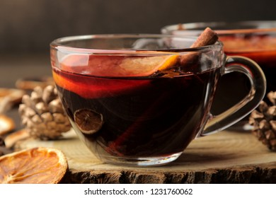 Hot mulled wine with cinnamon and orange in glass cups against a dark background. Christmas. new Year. close-up