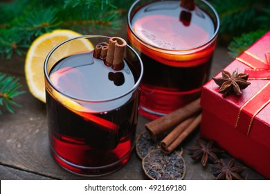 Hot mulled wine with spices, gift box and lemon