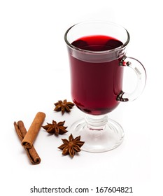 Hot mulled wine with spices isolated on a white background.