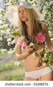 Hot natural blond over blossom trees background