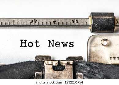 Hot news typed words on a vintage typewriter. Close up.