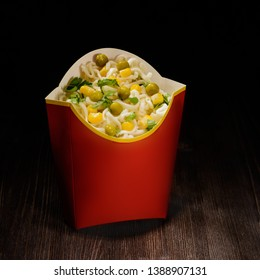 hot noodles with peas and corn in paper dishes