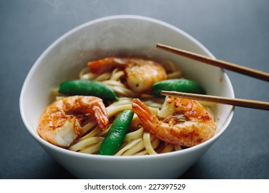 hot noodles with shrimps on a black background