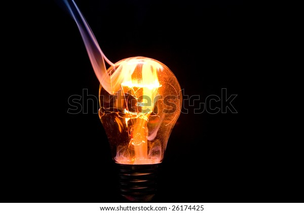 Hot orange burning lightbulb on black background