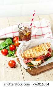 Hot panini with cola