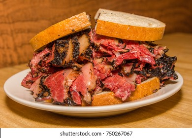 hot pastrami sandwich on fresh rye bread on plate